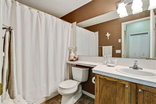Photo 9: 101 1997 Sirocco Drive SW in Calgary: Signal Hill Row/Townhouse for sale : MLS®# A1142333