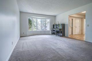 Photo 5: 319 Parkland Way SE in Calgary: Parkland Detached for sale : MLS®# A1102560