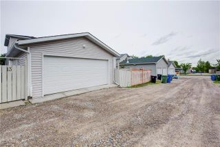 Photo 2: 13 BRIDLEGLEN Manor SW in Calgary: Bridlewood Detached for sale : MLS®# C4302730