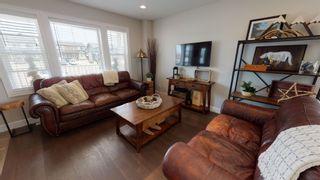 """Photo 3: 8320 88 Street in Fort St. John: Fort St. John - City SE 1/2 Duplex for sale in """"MATTHEWS PARK"""" (Fort St. John (Zone 60))  : MLS®# R2602097"""