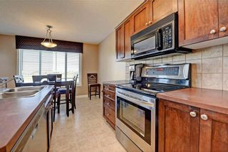 Photo 10: 784 LUXSTONE Landing SW: Airdrie House for sale : MLS®# C4160594