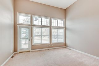 Photo 5: 100 28 Heritage Drive: Cochrane Row/Townhouse for sale : MLS®# A1076913