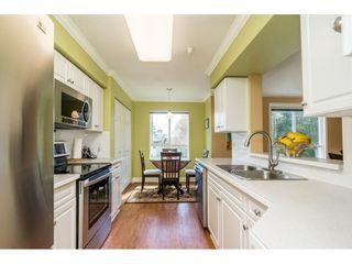 "Photo 10: 228 13880 70 Avenue in Surrey: East Newton Condo for sale in ""Chelsea Gardens"" : MLS®# R2563447"