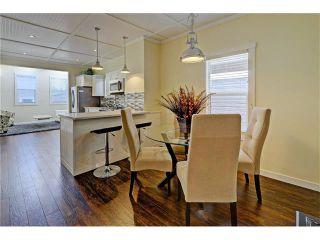 Photo 4: 309 28 AV NE in Calgary: Tuxedo Park House for sale : MLS®# C4066138