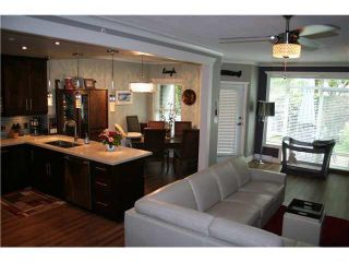 """Photo 4: 105 3600 WINDCREST Drive in North Vancouver: Roche Point Townhouse for sale in """"RAVEN WOODS"""" : MLS®# V1101013"""