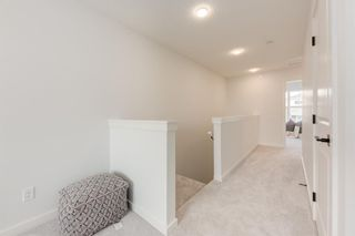 Photo 22: 249 Lucas Avenue NW in Calgary: Livingston Row/Townhouse for sale : MLS®# A1102463