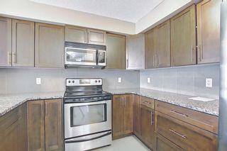 Photo 4: 108 500 Rocky Vista Gardens NW in Calgary: Rocky Ridge Apartment for sale : MLS®# A1136612