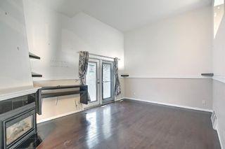 Photo 3: 1002 919 38 Street NE in Calgary: Marlborough Row/Townhouse for sale : MLS®# A1140399