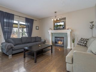 Photo 2: 27 Cougar Plateau Way SW in Calgary: Cougar Ridge Detached for sale : MLS®# A1113604
