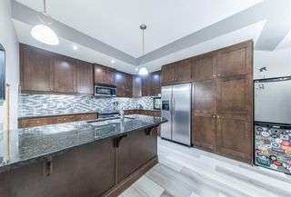 Photo 7: 1936 24A Street SW in Calgary: Richmond Row/Townhouse for sale : MLS®# A1086373
