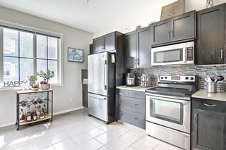 Photo 8: 2304 125 Panatella Way NW in Calgary: Panorama Hills Row/Townhouse for sale : MLS®# A1121817