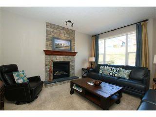 Photo 5: 188 SUNSET Close: Cochrane House for sale : MLS®# C4115906