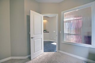 Photo 8: 47 ASPENSHIRE Drive SW in Calgary: Aspen Woods Detached for sale : MLS®# A1106772