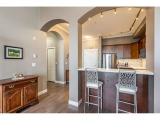 """Photo 4: 405 2627 SHAUGHNESSY Street in Port Coquitlam: Central Pt Coquitlam Condo for sale in """"Villagio"""" : MLS®# R2595502"""