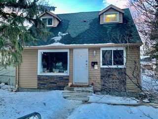 Photo 1: 705 Carter Avenue in Winnipeg: Crescentwood Residential for sale (1B)  : MLS®# 202103606