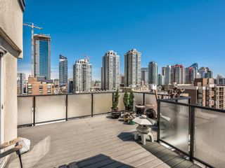 Photo 1: 704 1208 14 Avenue SW in Calgary: Beltline Apartment for sale : MLS®# A1098111