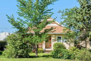 Photo 2: 210 Frontenac Avenue: Turner Valley Detached for sale : MLS®# A1140877