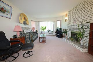 Photo 2: 1878 E 51ST Avenue in Vancouver: Killarney VE House for sale (Vancouver East)  : MLS®# R2596182