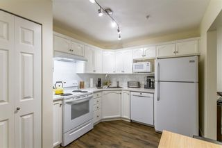 """Photo 8: 214A 301 MAUDE Road in Port Moody: North Shore Pt Moody Condo for sale in """"Heritage Grand"""" : MLS®# R2466859"""