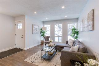 Photo 2: 2411 80 Street in Edmonton: Zone 29 House for sale : MLS®# E4229031