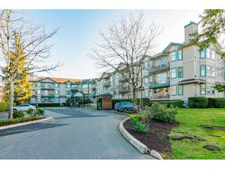 "Photo 1: 104 10756 138 Street in Surrey: Whalley Condo for sale in ""Vista Ridge"" (North Surrey)  : MLS®# R2528394"