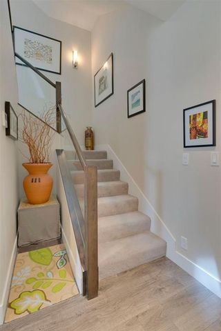 Photo 18: 113 Confluence Mews SE in Calgary: Downtown East Village Row/Townhouse for sale : MLS®# A1138938