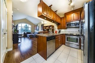 Photo 1: 403 12525 190A Street in Pitt Meadows: Condo for sale : MLS®# R2311707