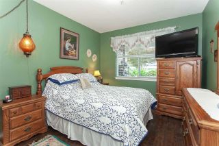 """Photo 12: #113 17712 57A Avenue in Surrey: Cloverdale BC Condo for sale in """"West on the Village Walk"""" (Cloverdale)  : MLS®# R2439030"""