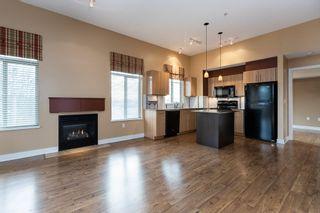 "Photo 9: 404 12020 207A Street in Maple Ridge: Northwest Maple Ridge Condo for sale in ""Westbrooke"" : MLS®# R2529905"