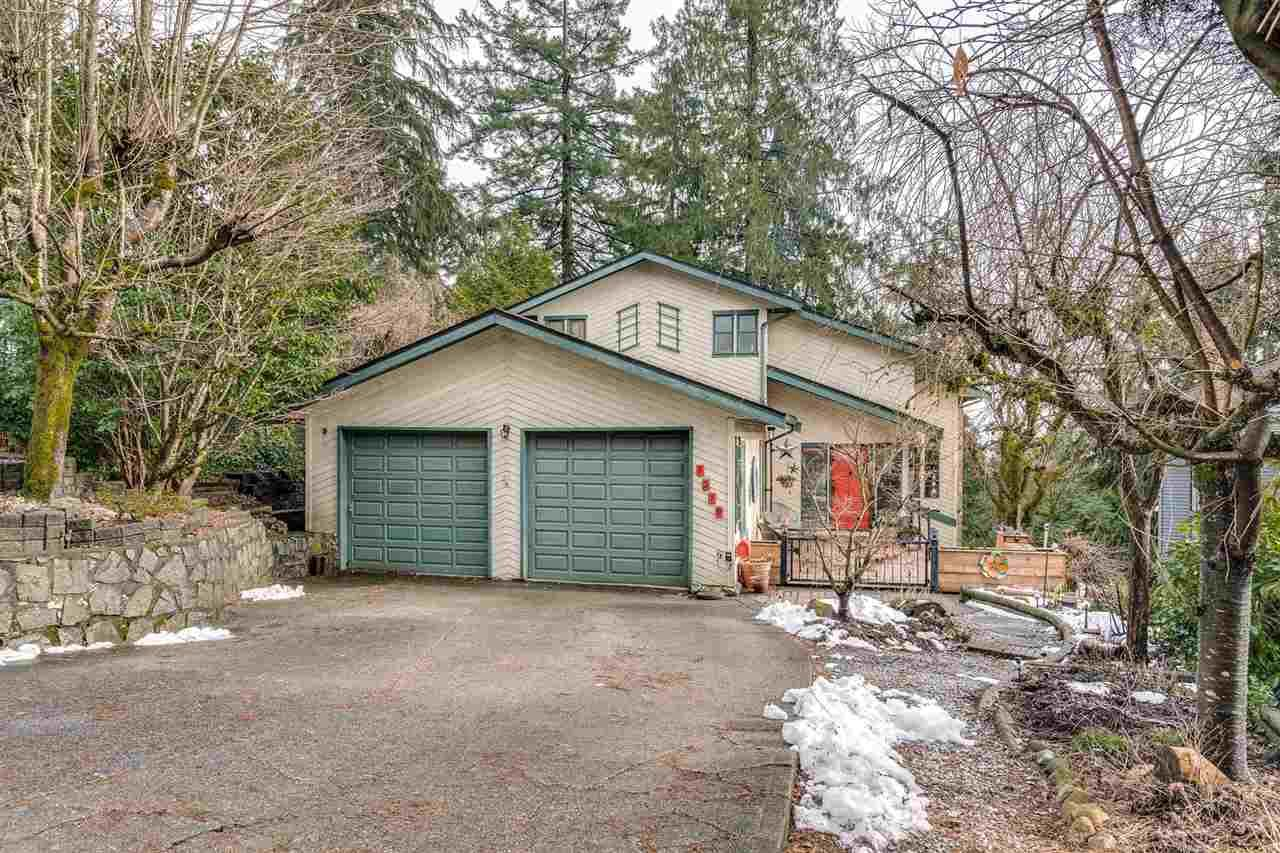"Main Photo: 1319 CHARTER HILL Drive in Coquitlam: Upper Eagle Ridge House for sale in ""EAGLE RIDGE"" : MLS®# R2542587"