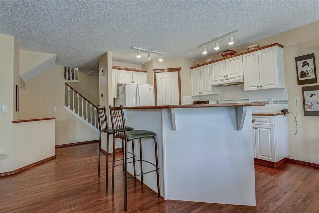 Photo 8: Photos: 127 Bridlewood Circle SW in Calgary: Bridlewood Detached for sale : MLS®# A1123607