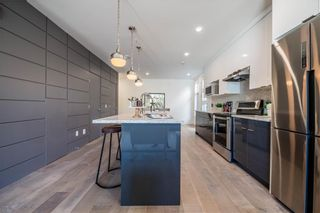 Photo 7: 105 1632 20 Avenue NW in Calgary: Capitol Hill Row/Townhouse for sale : MLS®# A1068096