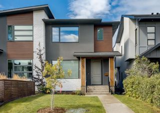Main Photo: 519 36 Street SW in Calgary: Spruce Cliff Semi Detached for sale : MLS®# A1143679