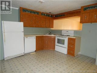 Photo 8: 10208 & 10210 98 Avenue in High Level: House for sale : MLS®# A1087602