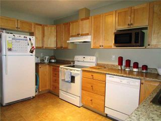 """Photo 3: 7916 97TH Avenue in Fort St. John: Fort St. John - City SE 1/2 Duplex for sale in """"NORTH ANNEOFIELD"""" (Fort St. John (Zone 60))  : MLS®# N234446"""