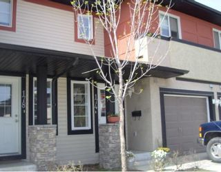 Photo 1: 153 EVERSYDE Common SW in Calgary: Evergreen Townhouse for sale : MLS®# C3386146