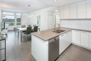 """Photo 1: 406 3263 PIERVIEW Crescent in Vancouver: South Marine Condo for sale in """"Rhythm"""" (Vancouver East)  : MLS®# R2480394"""