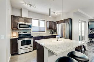 Photo 2: 2202 604 East Lake Boulevard NE: Airdrie Apartment for sale : MLS®# A1061237