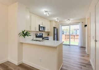 Photo 9: 402 2445 Kingsland Road SE: Airdrie Row/Townhouse for sale : MLS®# A1107683