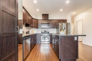 """Photo 8: 6880 208 Street in Langley: Willoughby Heights Condo for sale in """"Milner Heights"""" : MLS®# R2583647"""