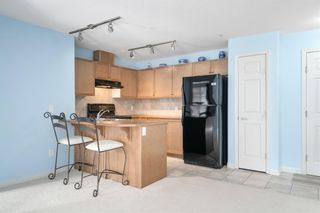 Photo 9: 3215 92 Crystal Shores Road: Okotoks Apartment for sale : MLS®# A1103721