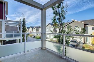 Photo 13: 555 Redstone View NE in Calgary: Redstone Row/Townhouse for sale : MLS®# A1149779