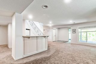 Photo 24: 64 strathlea Place SW in Calgary: Strathcona Park Detached for sale : MLS®# A1117847