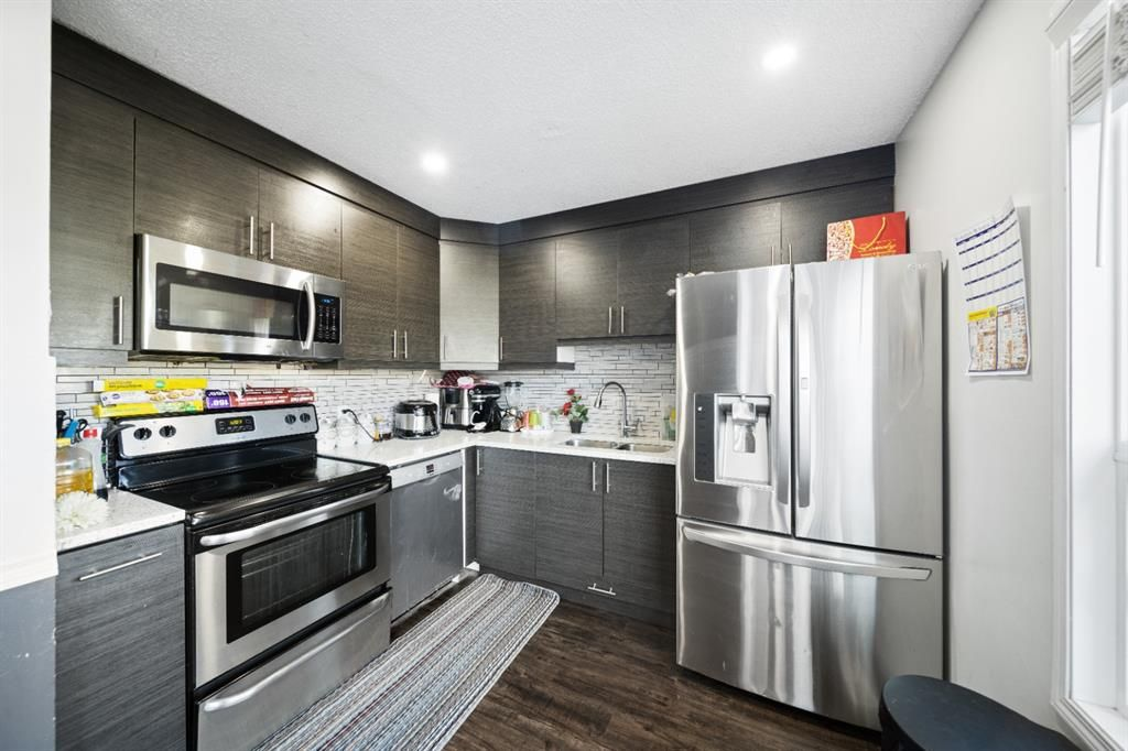 Main Photo: 3 4360 58 Street NE in Calgary: Temple Row/Townhouse for sale : MLS®# A1141104