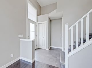 Photo 6: 27 Aspen Hills Common SW in Calgary: Aspen Woods Row/Townhouse for sale : MLS®# A1134206
