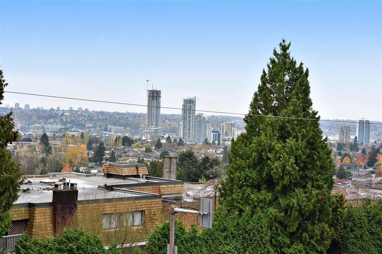 "Main Photo: 210 5450 EMPIRE Drive in Burnaby: Capitol Hill BN Condo for sale in ""EMPIRE PLACE"" (Burnaby North)  : MLS®# R2131500"