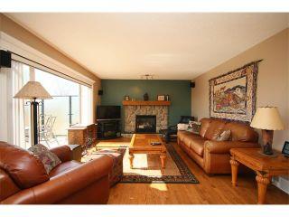 Photo 8: 51 GLENEAGLES View: Cochrane House for sale : MLS®# C4008842