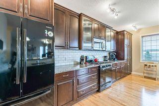 Photo 9: 137 CIMARRON VISTA Crescent: Okotoks Detached for sale : MLS®# C4206369