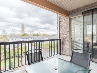 """Photo 34: 301 5655 210A Street in Langley: Langley City Condo for sale in """"CORNERSTONE NORTH"""" : MLS®# R2548771"""