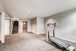 Photo 6: 335 Woodpark Place SW in Calgary: Woodlands Detached for sale : MLS®# A1110869